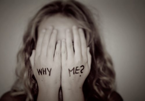 "Girl with ""why me?"" written on her hands"
