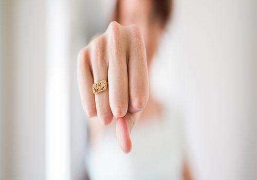 "Female fist - ring saying ""badass"""